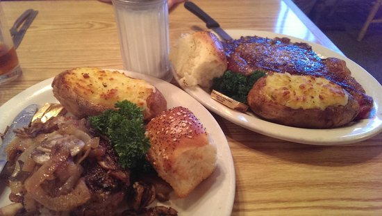 Boondocks Restaurant : Near: chopped buffalo steak. Far: beef ribeye. Both cooked perfectly. Twice-baked potatoes good