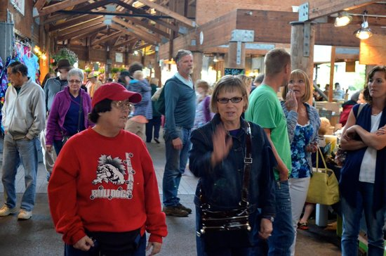 Farmers Market: Karen and Anita stroll through one of the large isles of the market