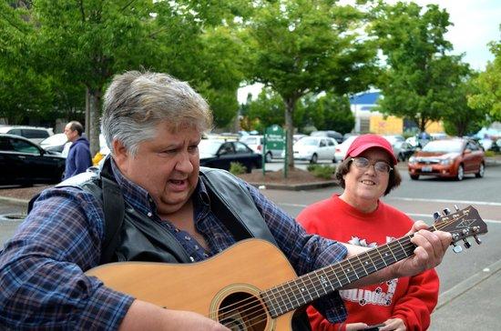 Farmers Market: A musician plays Karen a special folk tune at the Farmer's Market