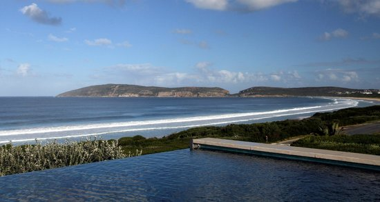 Periwinkle Guest Lodge: View of the bay from the infinity pool
