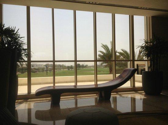 The Address Montgomerie Dubai: hall and reception area, view over golf course