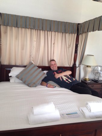 Babbacombe Bay Hotel: My hubby enjoying the comfort of the four poster bed!