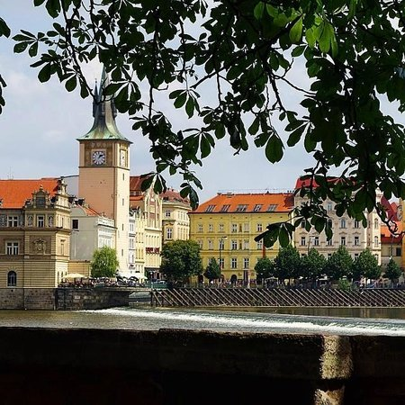Charles Bridge Palace: Hotel is the yellow building-view from across the Charles River, near the famous bridge