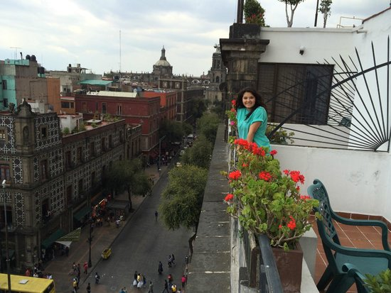 Hotel Gillow : The spacious balcony with Centro Historico view, greenery and flowers, and furniture.