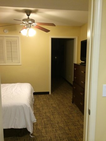 Wyndham Vacation Resorts Towers on the Grove : Guest bedroom which leads to living room.
