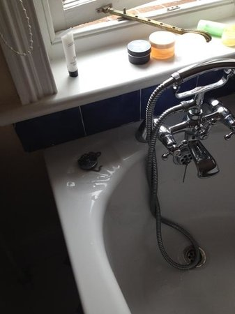 Grovefield Manor: broken chair in bath