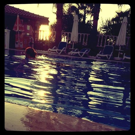 Adora Apart: The pool in the evening