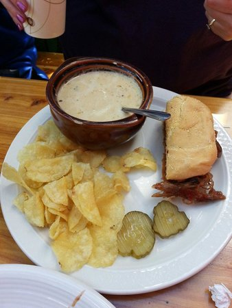 Muddy Boots Cafe: Judi Judi Judi - half pulled pork sandwhich and creamy potato soup, kettle chips, and two slices
