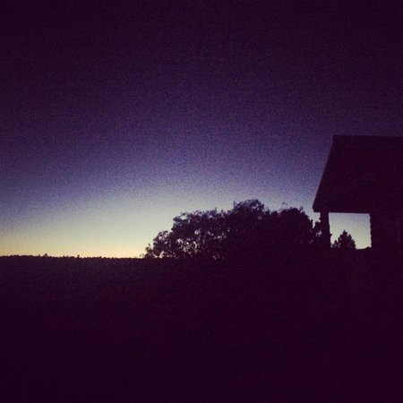 Zion Ponderosa Ranch Resort: Our cabin at dusk