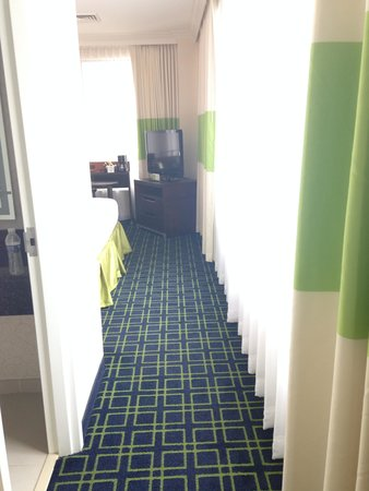 Royal St Charles Hotel: Hallway from living room to bedroom in suite - wall of windows