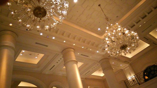 The Leela Palace New Delhi: The ornate chandeliers above the lobby