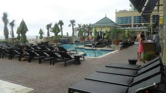 """Oceanaire Resort Hotel: adult pool by tiki bar to the right is the """"indoor"""" pool but the walls come open all the way"""