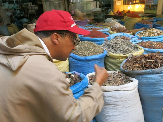 Marrakech Urban Adventures: Our guide showing us spices