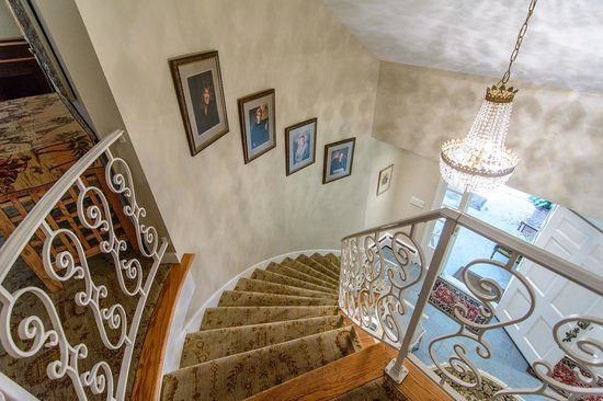 Stairway Leads To Upstairs Guestrooms From Front Door Entry Kitchen
