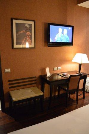 Writing desk, TV & Hotel Information folder.