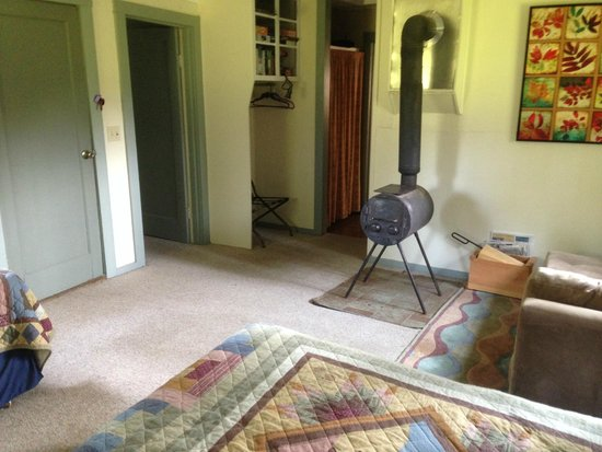 Glenwood, WA: Wood burning stove in main cabin area, also 2 beds