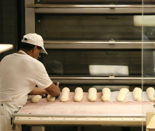 Off The Eaten Path Tours: Preparing loaves....be prepared to purchase the one w/ prosciutto.