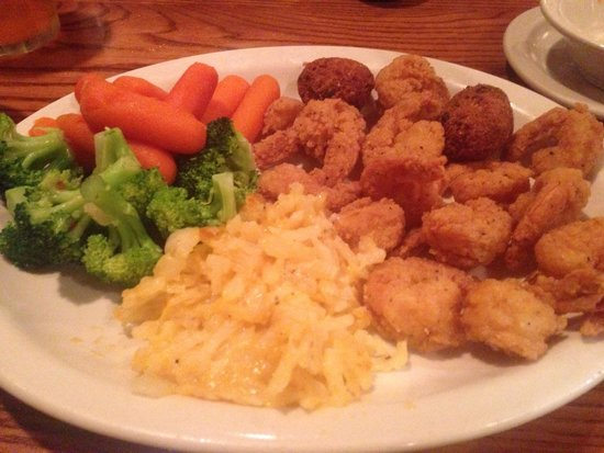Cracker Barrel : Fried shrimp with hash browns, broccoli and carrots. And hushpuppies! Delicious.