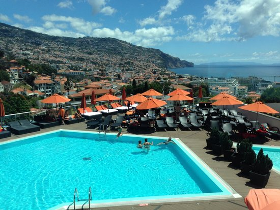 View over the pool to the city and the harbour - Four Views Baia