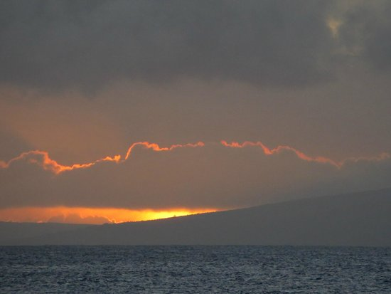Kaleialoha Condominiums: Condo view of sunset over Moloka'i