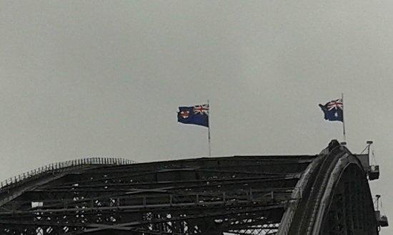 Pylon Lookout at Sydney Harbour Bridge : Flags over the Harbour Bridge