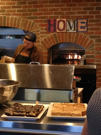 Home Cafe & Marketplace : Pizza chef working on the next order