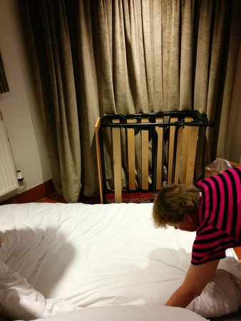 Dorian House : Mother-in-law making bed on the floor after extr bed got broken and there was no staff members