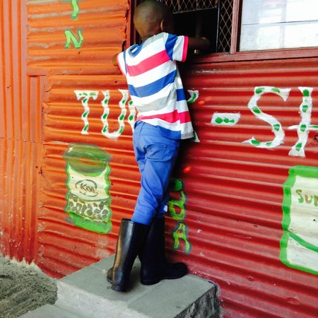 Uthando Tours: One of the gum shoe dancers at a local store