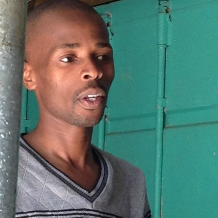 Uthando Tours: This young man leads the a cappella choir--the group's voices are strong and clear