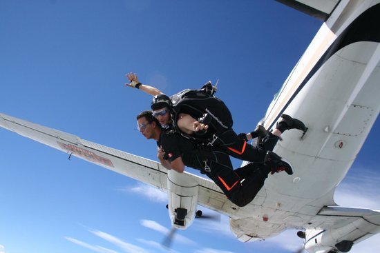 Westlock, Kanada: Exiting the airplane from 13000 feet on a tandem skydive