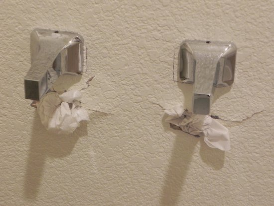 Americas Best Value Inn & Suites : Paper Holder with toilet paper in holes