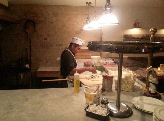 Grimaldi's : Making my pizza!