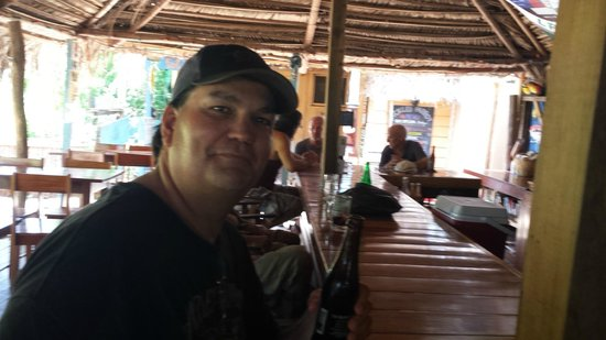 Pickled Parrot: Hubby enjoying his first Belikin of the trip