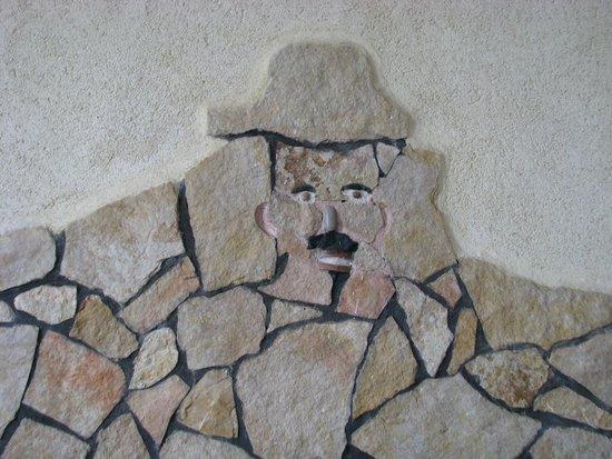 Lo Sfizio Ristorante Pizzeria: rappresentazione con opera muraria