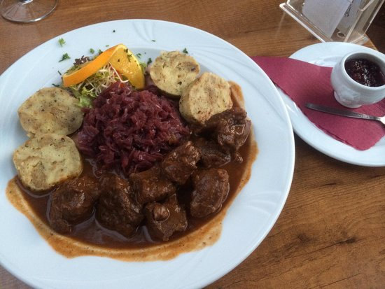 Game goulash with knodel (German dumplings) and red cabbage - Picture ...