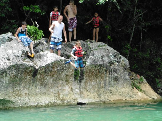 Cave Tubing.Bz: 7-year old doing the rock jump into the rivier