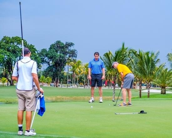Trump National Doral Golf Course: Our four caddie was very helpful