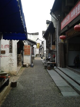 Longmen Ancient Town: Loking down the center of the street where most of the shops are located.