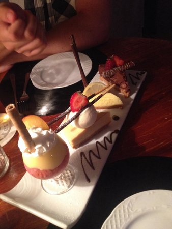 Oliver's With A Twist: 4 desserts to share; malteser cheesecake, lemon cheesecake, baileys cheesecake & sherry trifle..