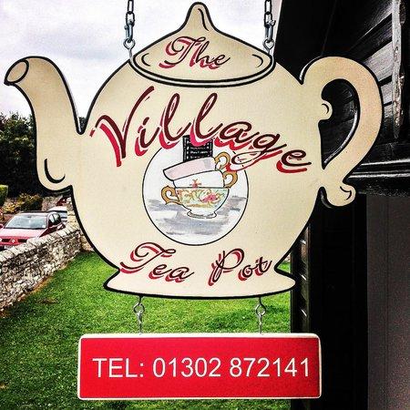 The Village Tea Pot