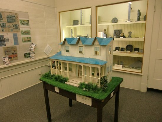 "Schuyler, VA: An assembled ""Waltons Farmhouse"" dollhouse."