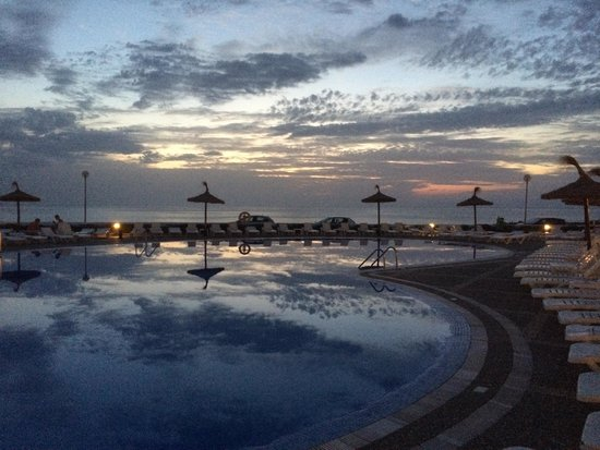 HYB Sea Club: Poolside view in the evening.