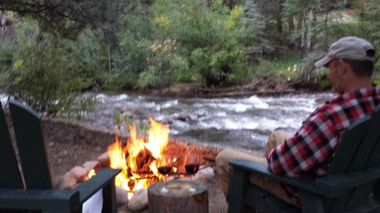 River Spruce: Enjoying the fire, river, and wine