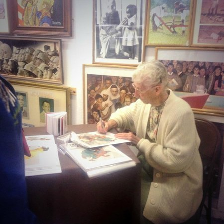 Norman Rockwell Exhibition : Ruth Skelllie signing prints for happy customers!