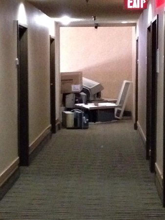 Santa Fe Comfort Inn: Junky old air-conditioners stored at the end of the third floor hallway. This was my view when I