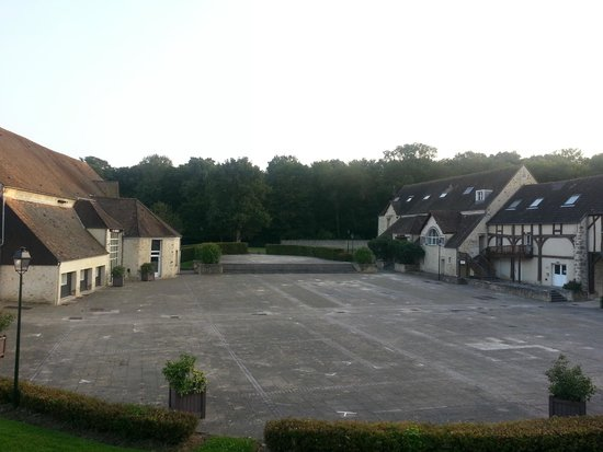 Auberge du Manet: View from room towards forest and historic buildings
