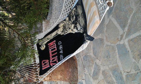 Villa Dimitri: My wife's favourite spot .... the hammock by the pool ...