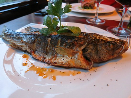 "Boat Hotel Matylda Ristorante: baked sea bass ""en papillote"" with lemon and basil"
