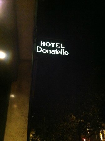 Hotel Donatello: The hotel sign at night. I liked that they kept the door locked.