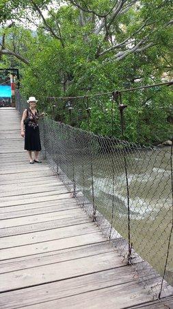 River Cafe: Access to the island via a suspension bridge.